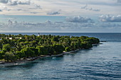 View of Avatoru Island from the passenger cargo ship Aranui 5 (Aranui Cruises) while sailing through the Tiputa Canal into the lagoon, Rangiroa Atoll, Tuamotu Islands, French Polynesia, South Pacific