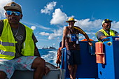 Cheerful sailors steer the dinghy of the passenger cargo ship Aranui 5 (Aranui Cruises), Rangiroa Atoll, Tuamotu Islands, French Polynesia, South Pacific