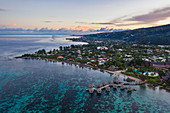 Aerial view of the Tahiti Ia Ora Beach Resort (managed by Sofitel) with overwater bungalows at sunset, near Papeete, Tahiti, Windward Islands, French Polynesia, South Pacific