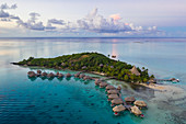 Aerial view of Sofitel Bora Bora Private Island Resort with overwater bungalows in Bora Bora lagoon at sunrise, Vaitape, Bora Bora, Leeward Islands, French Polynesia, South Pacific