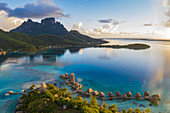 Aerial view of Sofitel Bora Bora Private Island Resort with overwater bungalows in Bora Bora lagoon with Mount Otemanu at sunrise, Vaitape, Bora Bora, Leeward Islands, French Polynesia, South Pacific