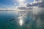 Aerial view of outrigger racing canoes in the Moorea Lagoon, Avamotu, Moorea, Windward Islands, French Polynesia, South Pacific