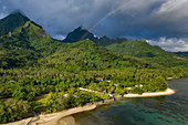 Aerial view of lush vegetation with rainbow and mountains in the distance, Teniutaoto, Moorea, Windward Islands, French Polynesia, South Pacific