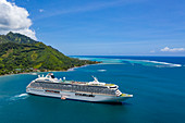 Aerial view of the Crystal Serenity (Crystal Cruises) cruise ship in Opunohu Bay, Moorea, Windward Islands, French Polynesia, South Pacific