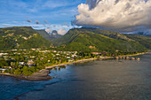 Aerial view of Tahiti Ia Ora Beach Resort (managed by Sofitel) with overwater bungalows and mountains behind, near Papeete, Tahiti, Windward Islands, French Polynesia, South Pacific
