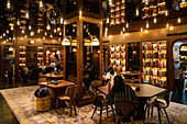 People relax in the library of the Six Senses Duxton Boutique Hotel in Chinatown, Singapore, Singapore, Asia