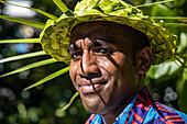 Friendly waiter with pandani hat at Malamala Island Beach Club, Mala Mala Island, Mamanuca Group, Fiji Islands, South Pacific