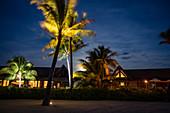 Coconut trees and Residence Villa accommodations at Six Senses Fiji Resort at night, Malolo Island, Mamanuca Group, Fiji Islands, South Pacific