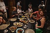 People enjoying barbecue dinner in a Residence Villa accommodation at Six Senses Fiji Resort, Malolo Island, Mamanuca Group, Fiji Islands, South Pacific