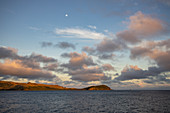 Clouds and moon over island at sunrise, Sawa-i-Lau Island, Yasawa Group, Fiji Islands, South Pacific