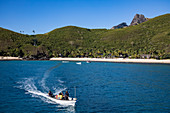 Local boat transfer from the island to the Yasawa Flyer II catamaran (South Seas Cruises), Waya Island, Yasawa Group, Fiji Islands, South Pacific