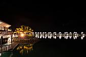 Overwater bungalows at the Fiji Marriott Resort Momi Bay at night, Momi Bay, Coral Coast, Viti Levu, Fiji Islands, South Pacific
