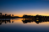 Silhouette of overwater bungalows at the Fiji Marriott Resort Momi Bay at daybreak, Momi Bay, Coral Coast, Viti Levu, Fiji Islands, South Pacific