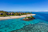 Aerial view of family enjoying water sports activities next to small barrier island at Six Senses Fiji Resort, Malolo Island, Mamanuca Group, Fiji Islands, South Pacific