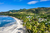 Aerial view of beach with coconut trees and village houses, Gunu, Naviti Island, Yasawa Group, Fiji Islands, South Pacific