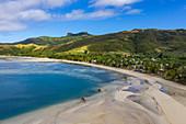 Aerial view of beach at low tide with village behind, Gunu, Naviti Island, Yasawa Group, Fiji Islands, South Pacific