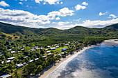 Aerial view of beach and village, Gunu, Naviti Island, Yasawa Group, Fiji Islands, South Pacific