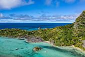Aerial view of passengers of the cruise ship MV Reef Endeavor (Captain Cook Cruises Fiji) relaxing and enjoying water sports activities on Blue Lagoon Beach, Sawa-i-Lau Island, Yasawa Group, Fiji Islands, South Pacific