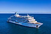 Aerial view of cruise ship MV Reef Endeavor (Captain Cook Cruises Fiji), Yaqeta, Yangetta Island, Yasawa Group, Fiji Islands, South Pacific