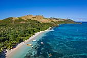 Aerial view of boats, beach and coast, Yaqeta, Yangetta Island, Yasawa Group, Fiji Islands, South Pacific