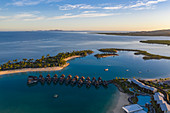 Aerial view of overwater bungalows at Fiji Marriott Resort Momi Bay at sunrise, Momi Bay, Coral Coast, Viti Levu, Fiji Islands, South Pacific