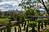 Gardens in front of the Kigali Genocide Memorial Center with town in the distance, Kigali, Kigali Province, Rwanda, Africa