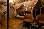 Interior of a luxury tent accommodation in the luxury resort tented camp Magashi Camp (Wilderness Safaris), Akagera National Park, Eastern Province, Rwanda, Africa