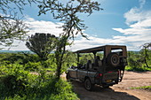Safari vehicle operated by luxury resort tented Magashi Camp (Wilderness Safaris), Akagera National Park, Eastern Province, Rwanda, Africa