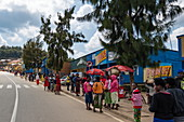 Street scene with many people wearing colorful clothes, near Mudasomwa, Southern Province, Rwanda, Africa