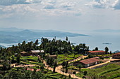 Buildings on hillside with Lake Kivu behind, near Gitesi, Western Province, Rwanda, Africa