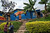 Trees and exterior of a colorful bar, Gisenyi, Western Province, Rwanda, Africa