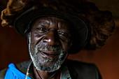 Portrait of an elderly man in the cultural village of Gorilla Guardians Village, Ruhengeri, Northern Province, Rwanda, Africa