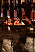 Charcoal provides a pleasant source of heat in the restaurant of the Tiloreza Volcanoes Eco Lodge, Ruhengeri, Northern Province, Rwanda, Africa