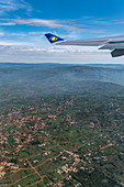 View out of window of a RwandAir Airbus A330-300 airplane with sun logo on winglet, on the flight from Kigali International Airport (KIG) in Rwanda, Africa to Brussels Airport (BRU) in Belgium, Europe