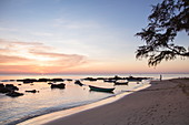 Silhouette of rocks and fishing boats on Ong Lang Beach at sunset, Ong Lang, Phu Quoc Island, Kien Giang, Vietnam, Asia