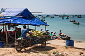 Motorcycle rickshaw with fresh fruit on Ganh Dau Beach with fishing boats behind it, Ganh Dau, Phu Quoc Island, Kien Giang, Vietnam, Asia