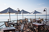 Tables and umbrellas in restaurant on Ong Lang Beach, Ong Lang, Phu Quoc Island, Kien Giang, Vietnam, Asia