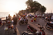 Mopeds and stalls for street food at sunset, Duong Dong, Phu Quoc Island, Kien Giang, Vietnam, Asia