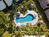 Aerial view of swimming pool in the garden of Cottage Village Phu Quoc Resort near Ong Lang Beach, Ong Lang, Phu Quoc Island, Kien Giang, Vietnam, Asia