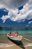 A fisherman bringing in his boat after being at sea. Shot in St. Lucia, West Indies.