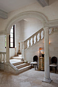 Interior shot of a white, sandstone hallway of a colonial style home in Antigua.