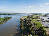 Aerial view of Tonle Sap River, village and rice fields, Kampong Prasat, Kampong Chhnang, Cambodia, Asia