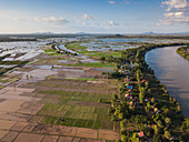 Aerial view of Tonle Sap River, village and rice fields, Kampong Prasat, Kampong Chhnang, Cambodia, Asia
