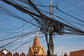 A chaotic yet functioning cluster of power and telephone lines near the Royal Palace complex, Phnom Penh, Cambodia, Asia