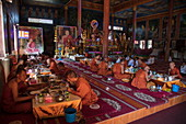 Buddhist monks from the Vipassana Dhura Mandala Meditation Center have lunch at the Udong Pagoda, Oudong (Udong), Kampong Speu, Cambodia, Asia
