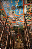 Beautiful painted ceiling and Buddha statue in Prasat Nokor Vimean Sour Temple, Oudong (Udong), Kampong Speu, Cambodia, Asia