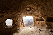 Natural windows inside cave at the entrance of Daniel Korkor rock-hewn church, Gheralta Mountains, Tigray Region, Ethiopia, Africa