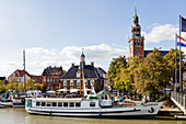 Salon ship (port music) in the harbor, town hall tower, harbor, Leer, East Frisia, Lower Saxony, Germany