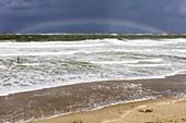 Rainbow on the horizon, North Sea, surf, flood, wind, beach, sand, rain, Norderney, East Frisia, Lower Saxony, Germany