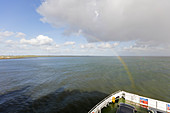Rainbow at the stern of the ferry, North Sea, ship, Schauer, Norderney, East Frisia, Lower Saxony, Germany